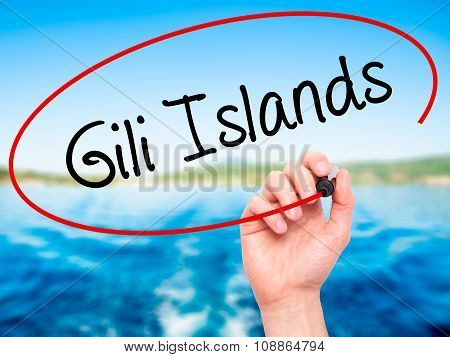 Man Hand writing Gili Islands with marker on visual screen.