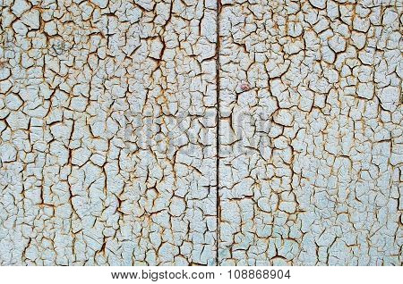 Rusty Metal Surface Which Has Cracked From Age
