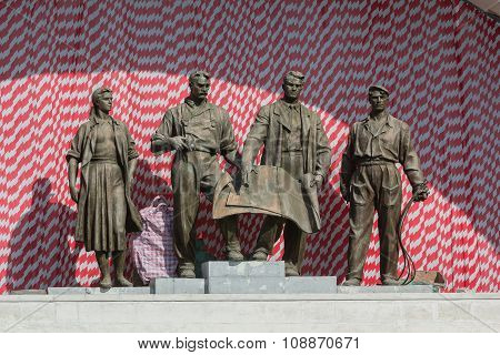 Sculptural Group Of Soviet Times Glorifying The Workers Of The Soviet Era. Kiev, Ukraine