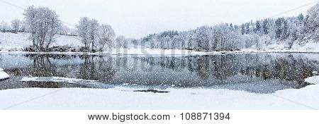 Beautiful winter river in snowfall