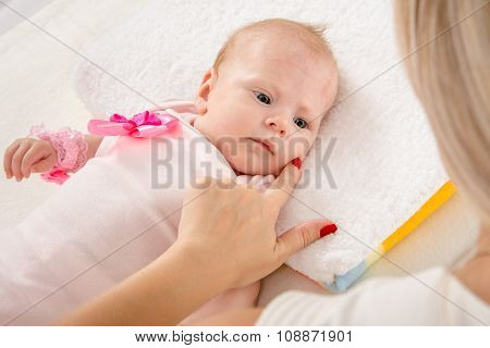 Mom Leaned Her Finger To Her Cheek Two-month Girl