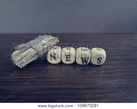 word news on cubes on a newspaper