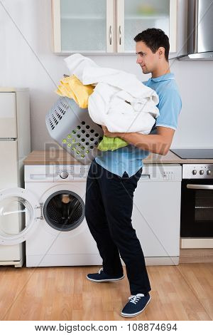 Man Carrying Heavy Laundry Basket
