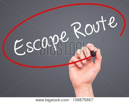 Man Hand writing Escape Route with  marker on visual screen