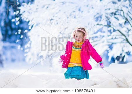 Little Girl Playing Snow Ball Fight In Winter Park