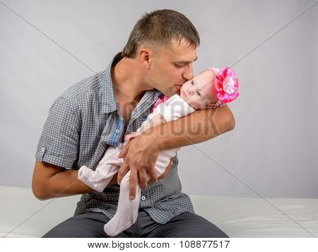 Happy Dad Kisses His Infant Daughter Two Months