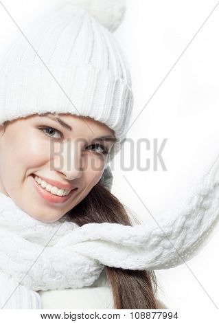 attractive young caucasian woman in warm clothing  in studio isolated on white smiling