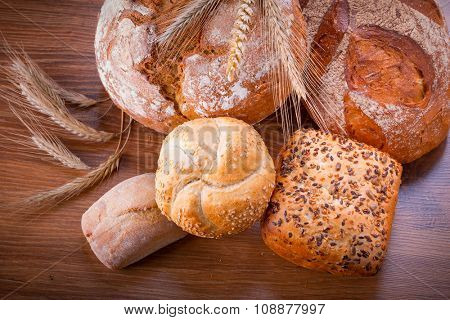 Assortment of fresh bread on wooden table