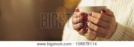 Woman Holding A Mug