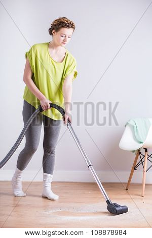 Housekeeper With Vacuum Cleaner