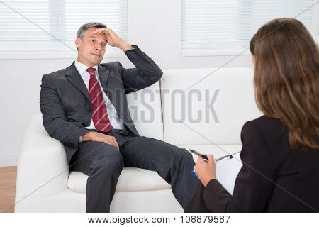 Psychiatrist Listening About Problem Of Patient
