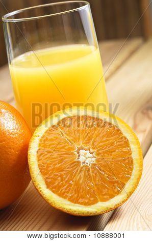 Glass Of Orange Juice On Table