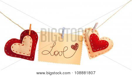 Paper hearts and sheet hang on cord isolated on white