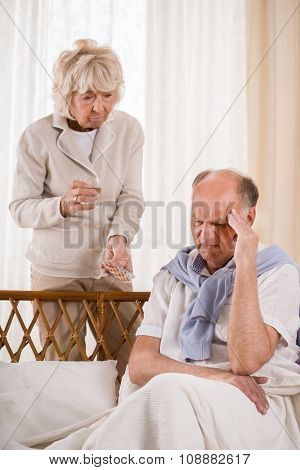Man With Migraine Taking Painkiller