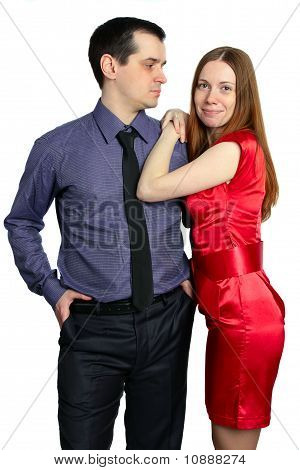 Man Looks At A Woman. Beautiful Couple Isolated On White