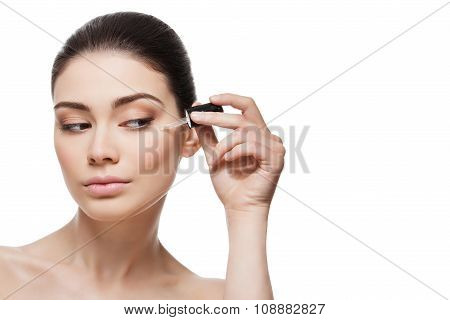 Girl applying serum