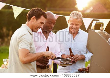 Mature Male Friends Enjoying Outdoor Summer Barbeque