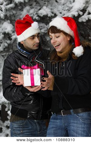 Young Couple With Gift Box