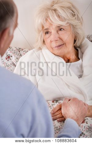 Sick Woman Supported By Her Husband