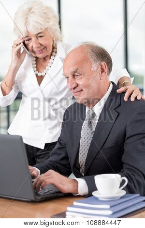 Director Working On A Laptop