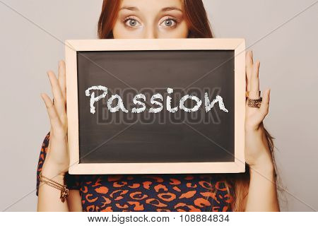 Young Woman Holding A Chalkboard Saying Passion