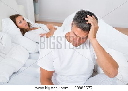 Sad Couple At Bedroom