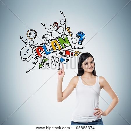 A Brunette Woman Is Pointing Out The Finger On The Colourful Sketch Of A Plan For Business Developme