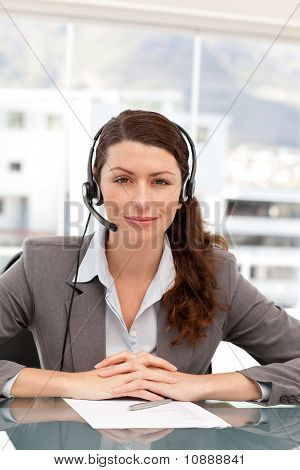 Portrait Of A Charismatic Businesswoman With Earpiece