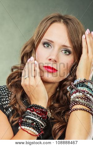 Elegant Woman Wearing Multiple Bracelets