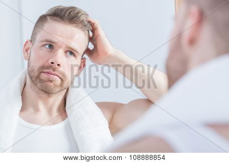 Guy Looking At The Mirror