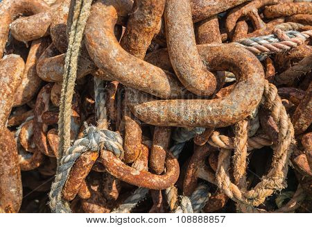 Ropes And Rusty Chain On A Heap