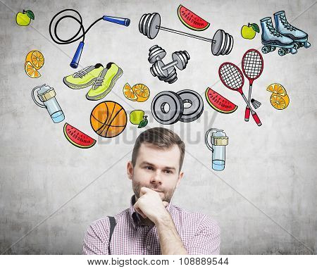 A Portrait Of A Dreaming Handsome Man Who Is Thinking About His Choice Of Sport Activity. Colourful