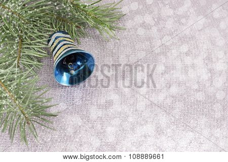 Christmas Ornament And Fir Tree On Shiny Sparkling Background