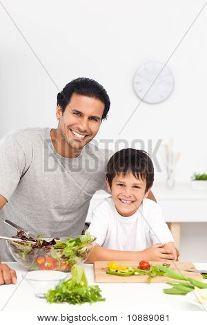 Portrait Of A Father And His Son Preparing Their Lunch