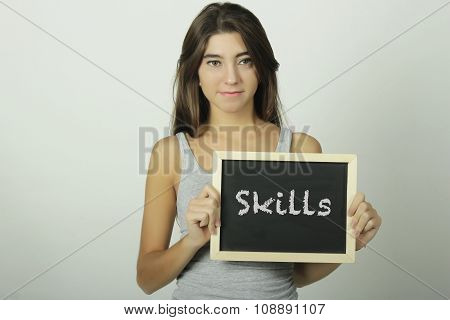 Young Woman Holding A Chalkboard Saying Skills.