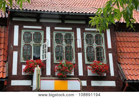 Three windows of half-timbering medieval house in Klaipeda, Lithuania.