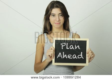 Young Woman Holding A Chalkboard Saying Plan Ahead.