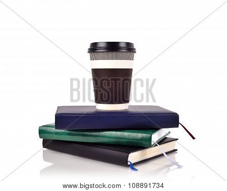 Coffee Cup On Book