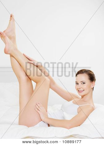 Smiling Young Woman With Beautiful Legs