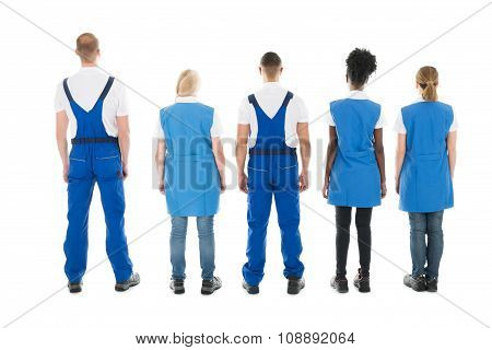 Rear View Of Multiethnic Janitors Standing In Row