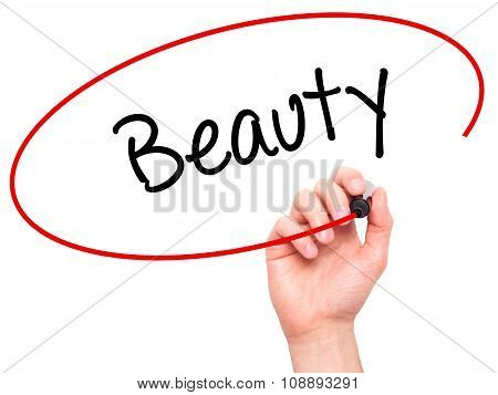 Man Hand writing Beauty with black marker on visual screen.