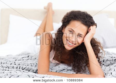 Beautiful Woman Lying On Her Bed