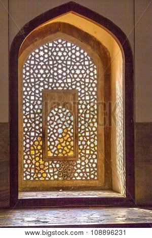 NEW DELHI, INDIA - JULY 3, 2012: beautiful windows with ornaments in islamic style inside humayuns tomb