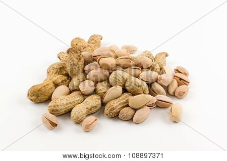 Hill Of A Peanut And Pistachios In A Shell Lies On A White Background