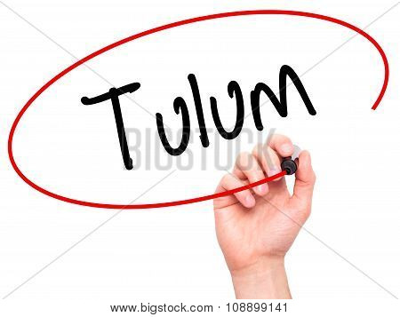 Man Hand writing Tulum with black marker on visual screen.
