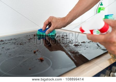 Janitor Cleaning Induction Stove