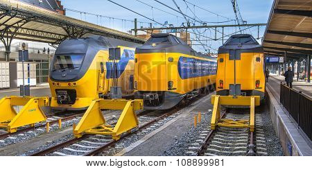 Three Fast Intercity Commuter Trains Waiting At A Station