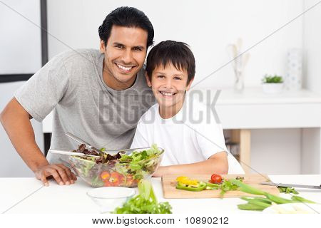 Portrait Of A Father And His Son Preparing A Salad