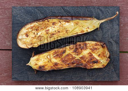 Grilled eggplant on wooden board shot from above