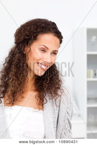Pensive Woman Standing In A Room